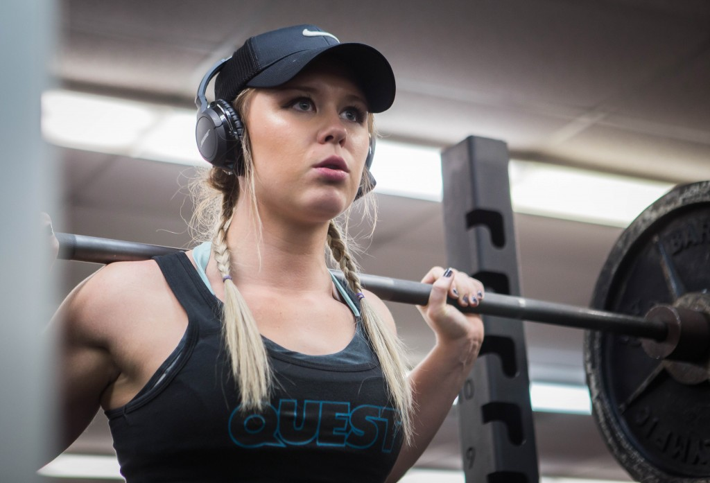 Stephanie Butch concentrates before squatting at the Student Activity Center, Friday, February 5, 2016. If a song comes on that doesn't pump Butch up, she has to change it while working out.