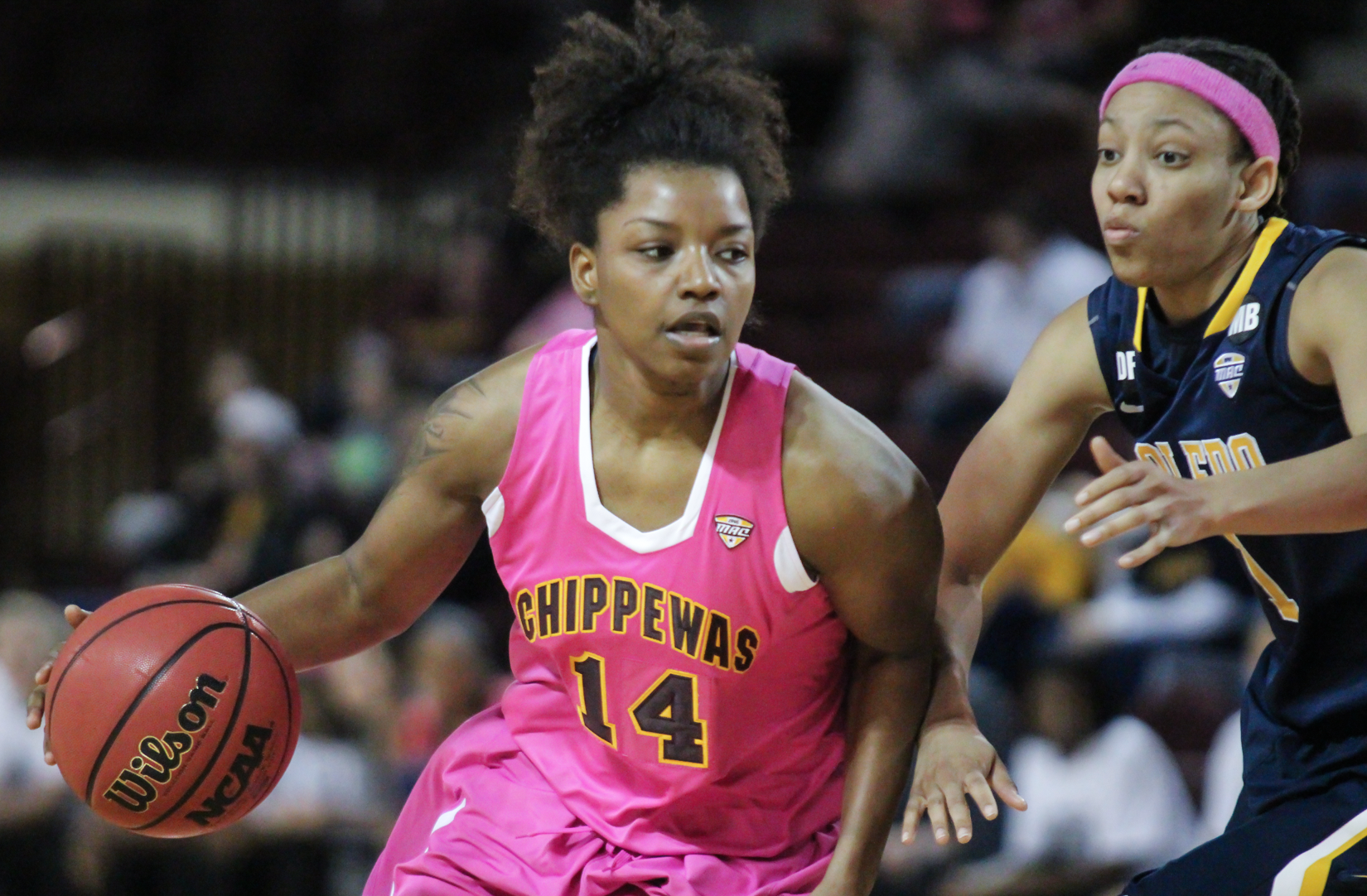Guard Amani Corley (14) drives the lane in the loss against Toledo at McGurick Arena on Saturday, Feb. 20.