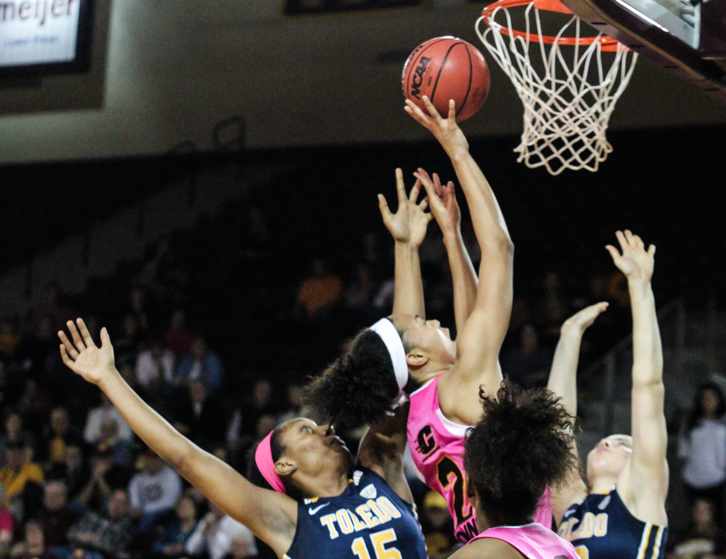Forward Tinara Moore grabs a rebound and the put back in the third quarter against Toledo at McGurick Arena on Saturday, Feb. 20.