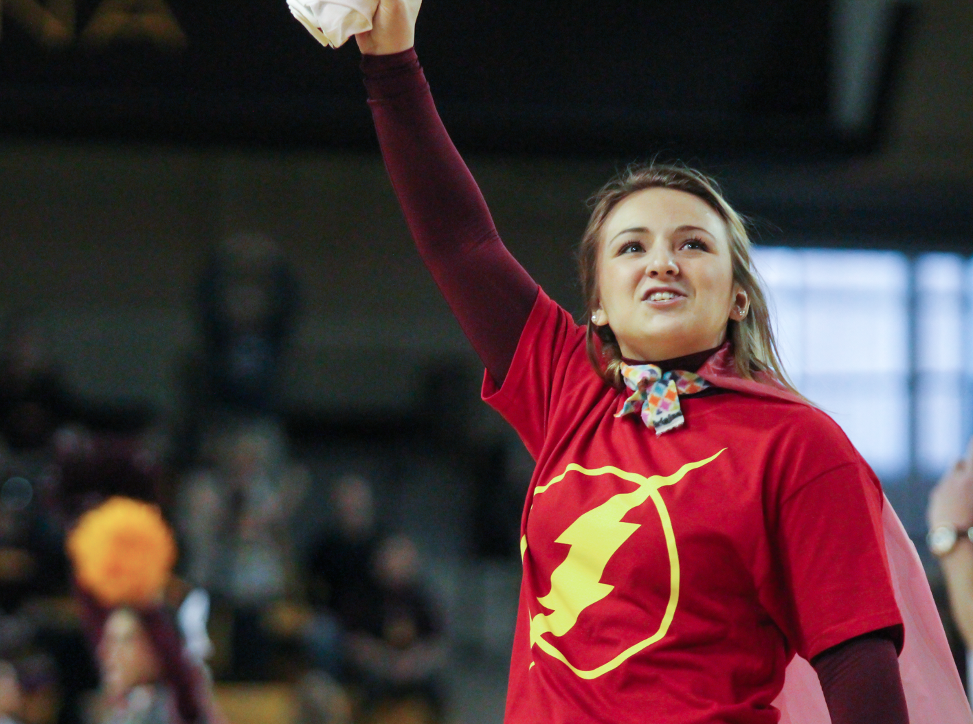 CMU cheerleader Taylor Fischer wears a Flash T-shirt during Superhero day at McGurick Arena on Saturday, Feb. 20.
