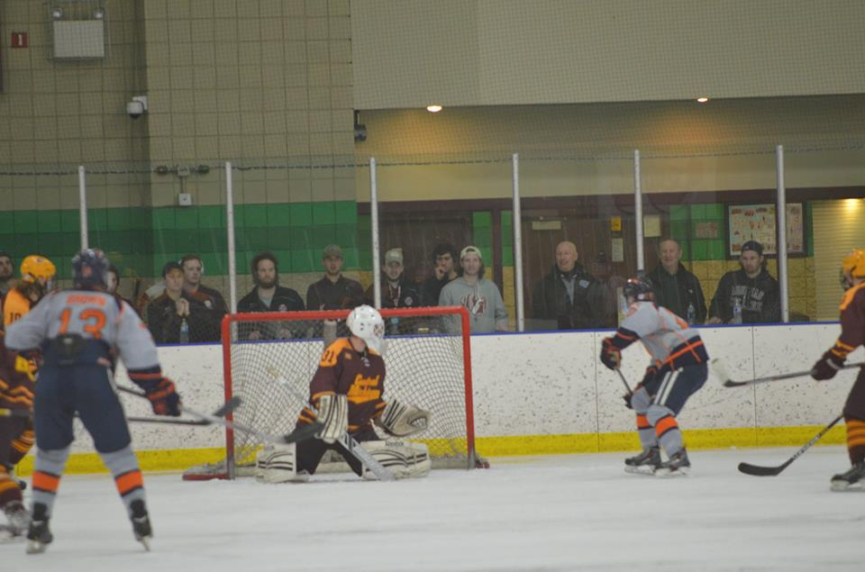 CMU Senior Goaltender Tyler Everlove prepares to make a save against Hope College in the ACHA Regional Finals.